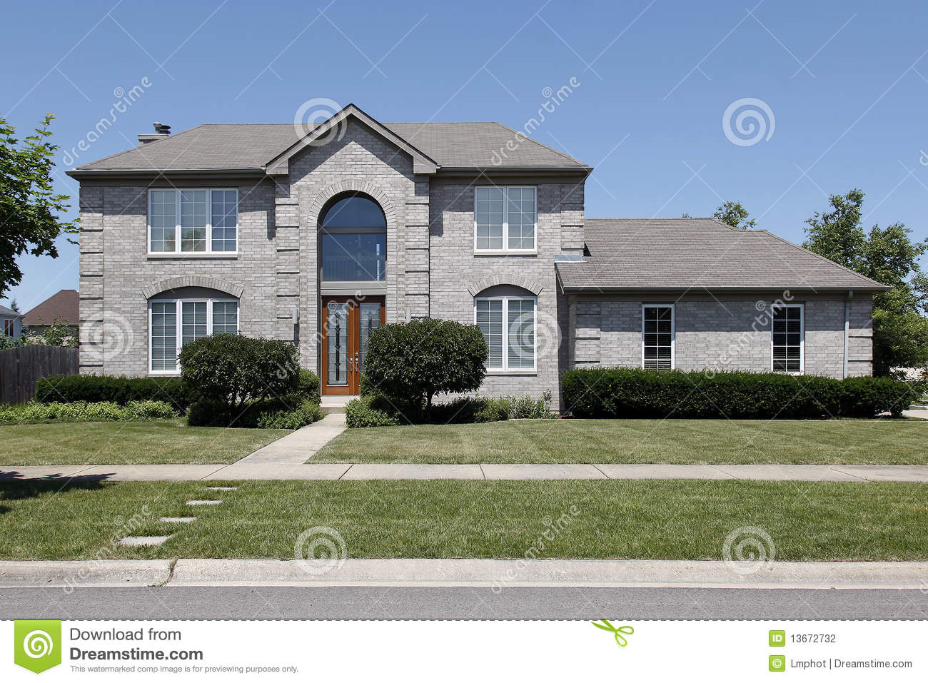 Gray Brick Home With Glass Door Stock Photography - Image: 13672732