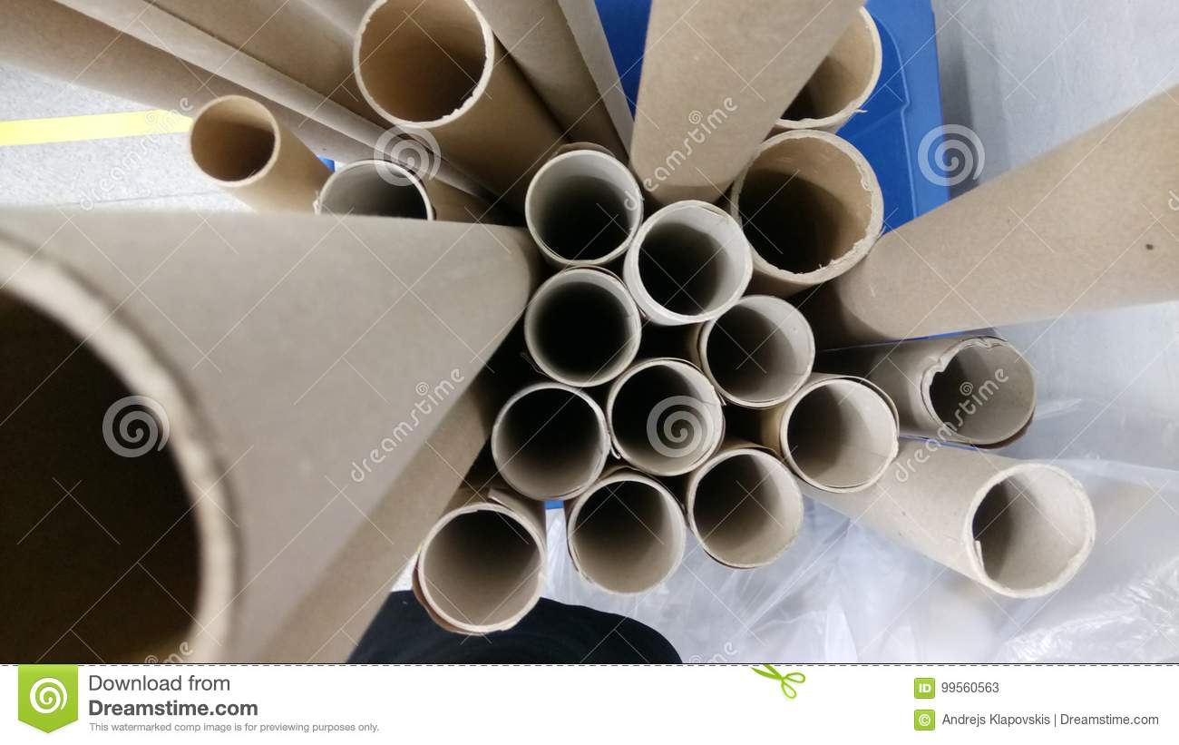 Gray cardboard tubes from fabrics. Concept: material, fabric, manufacture, garment factory, new samples of fabrics.