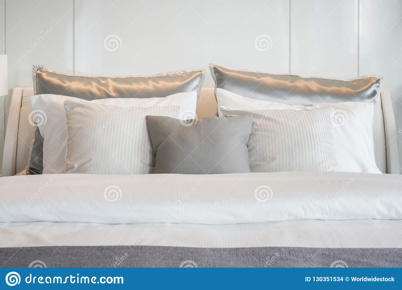 Gray Color Scheme Pillows Setting On Bed With Satin Finished Bedding Stock Photo Image Of Interior Mattress 130351534