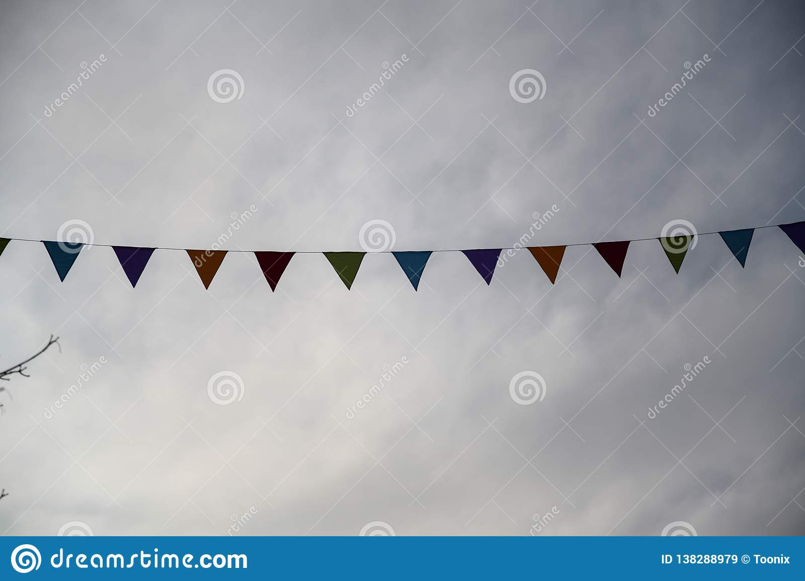 Festival garlands in front of a drab gray sky