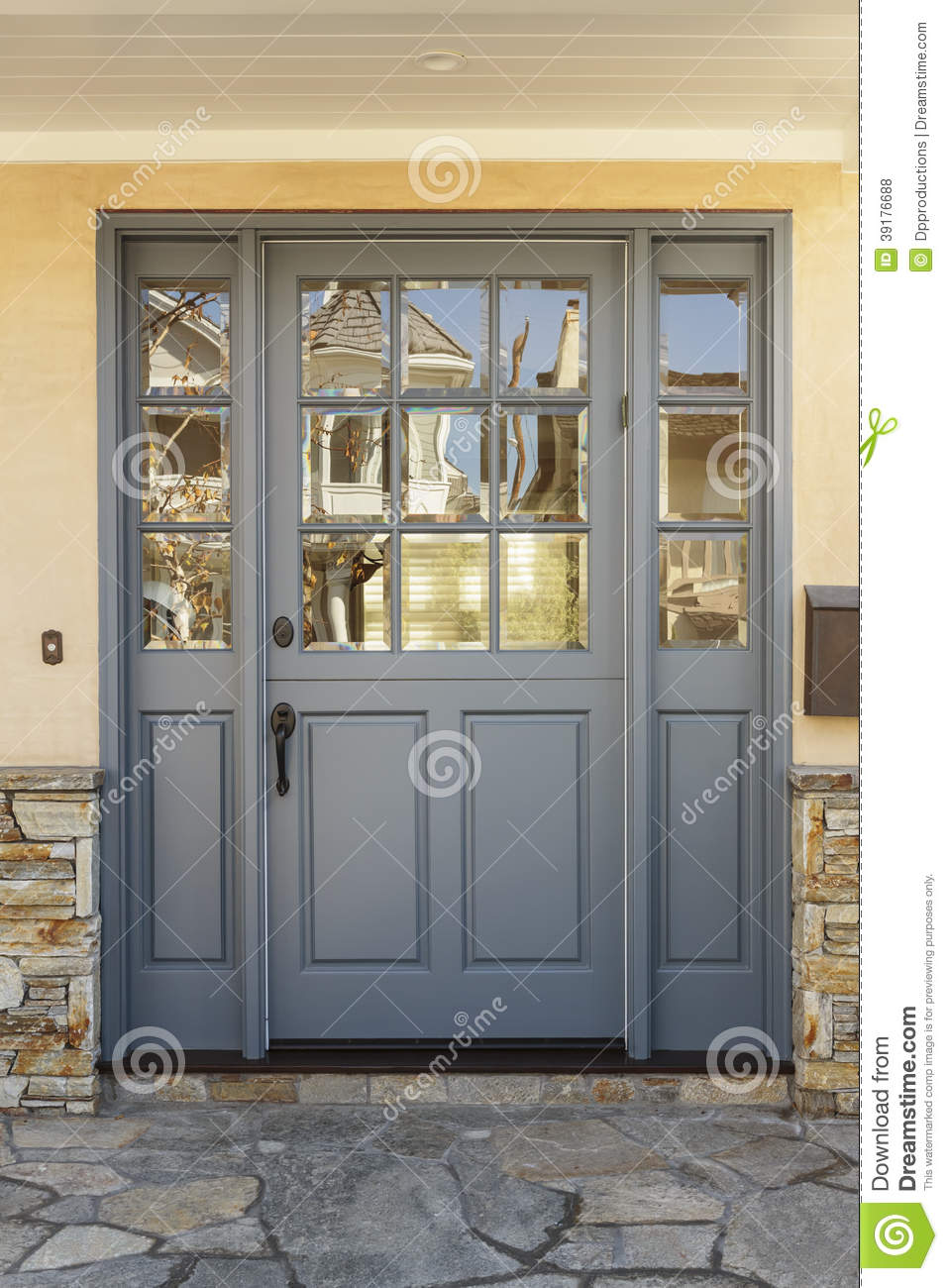 Gray Front Door To A Home With Shale Porch Stock Photo