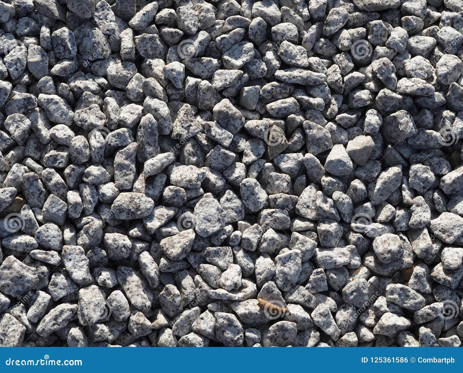 Gray gravel background - small stones. Stone aggregate.