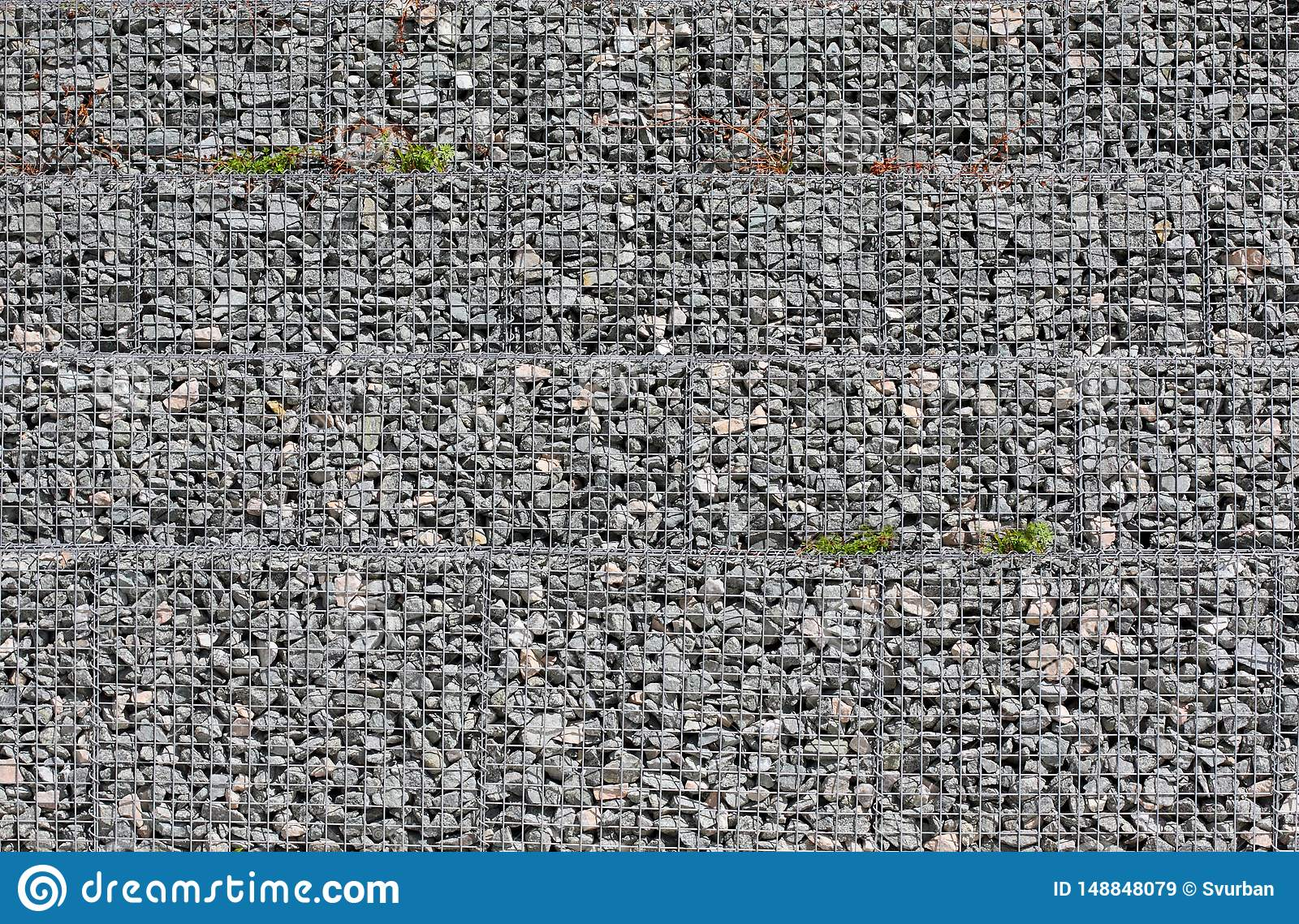 Grey ground stone rubble background of many small stones