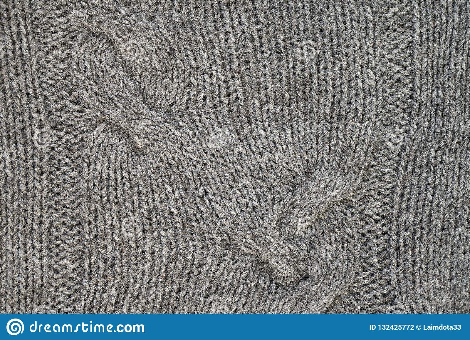 4678010bd2736 Gray knitted texture with a relief pattern. Handmade Knitwear. Background