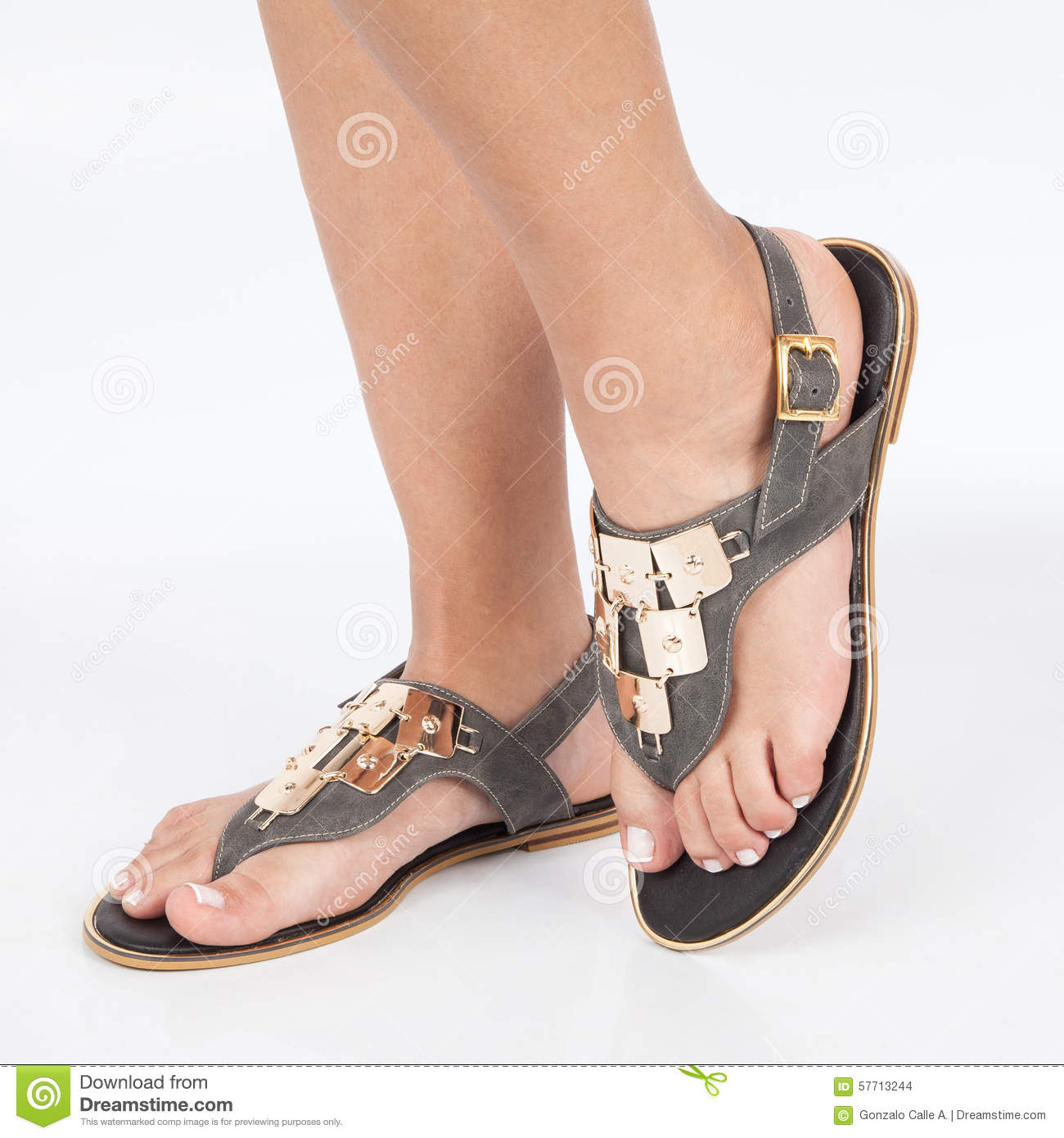 cd0dbd743aa1 Gray leather sandals with gold applied on feet the mujere on white  background
