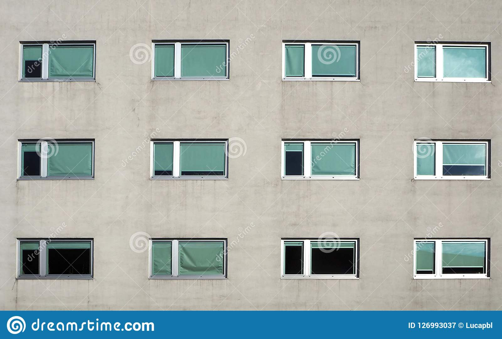 Ventanas Pvc Stock.Gray Modern Building Facade With New Pvc Windows Front View