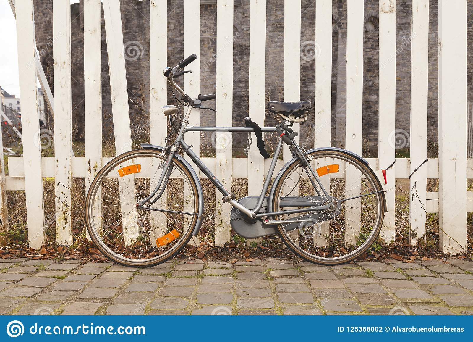 Gray, Old, Vintage And Retro Bicycle, Padlocked On A Wooden