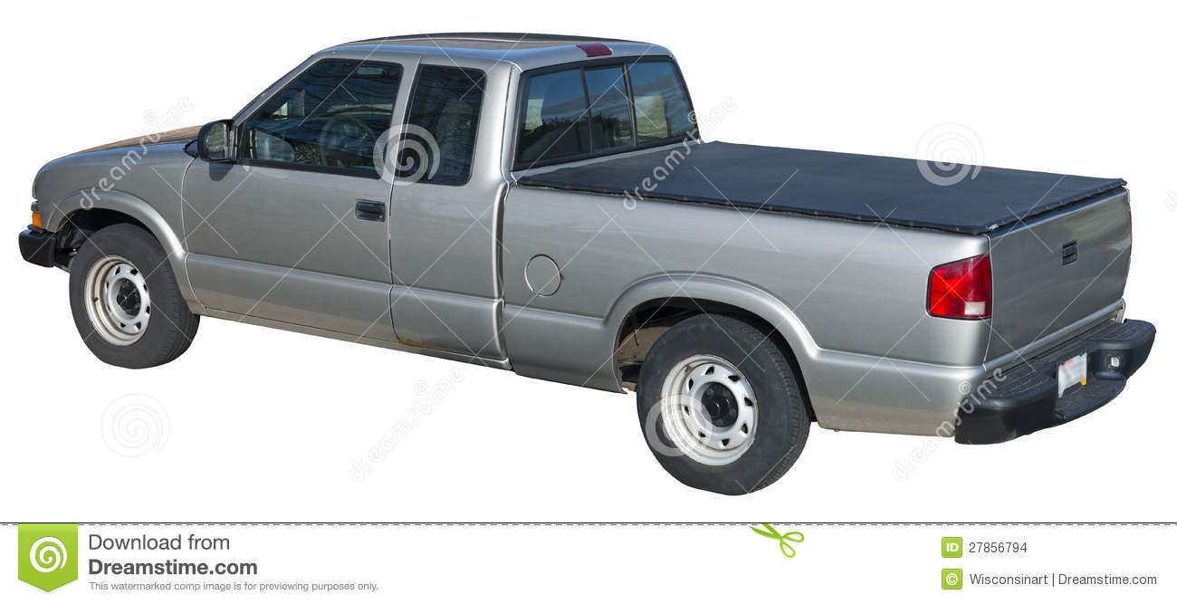 Gray Chevy S10 pickup truck with a tonneau cover over the bed. The ...