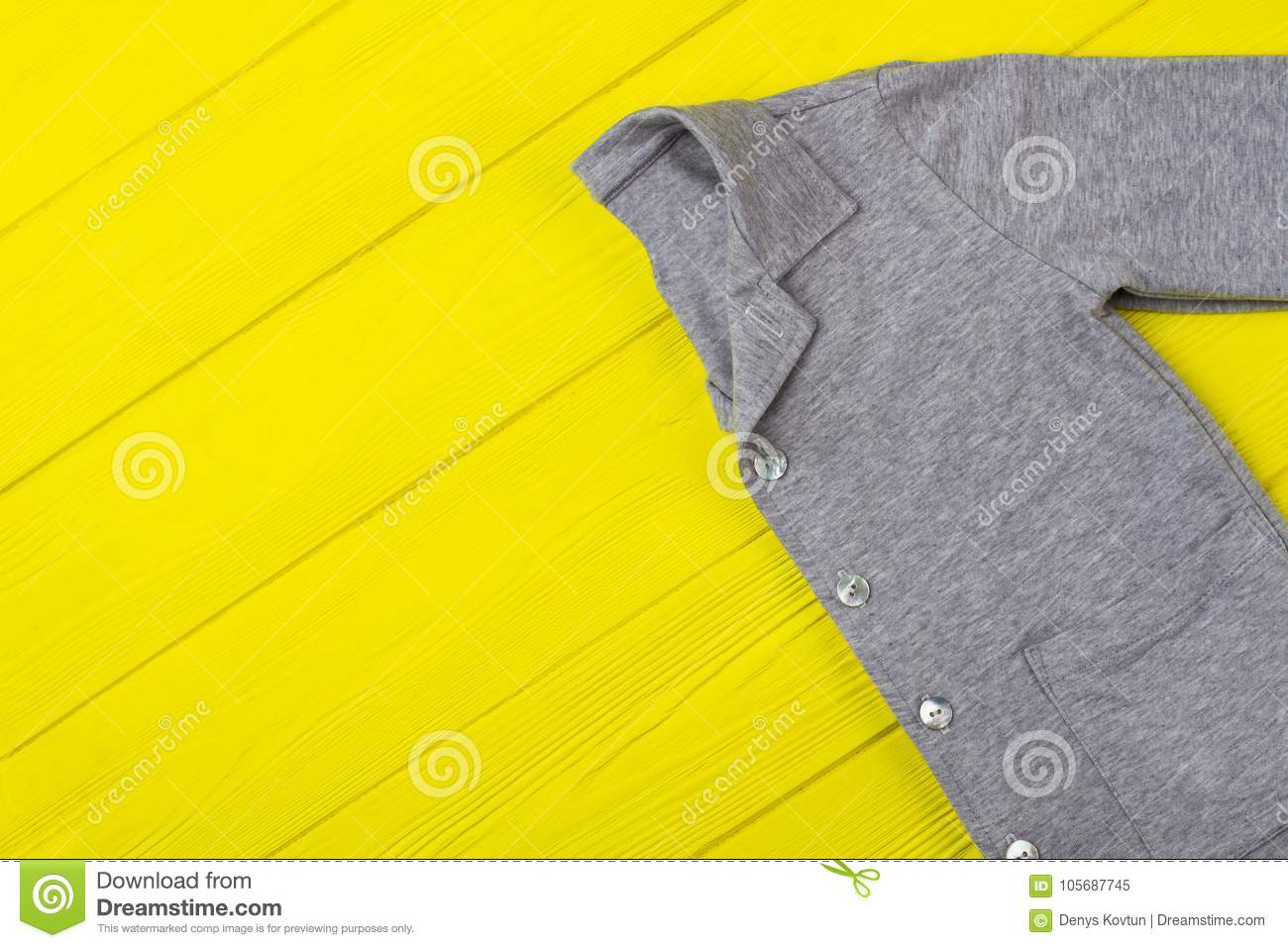cfc93004bb60 Gray shirt on yellow table. Sale of kids pajama. Bright background for  clothing store.
