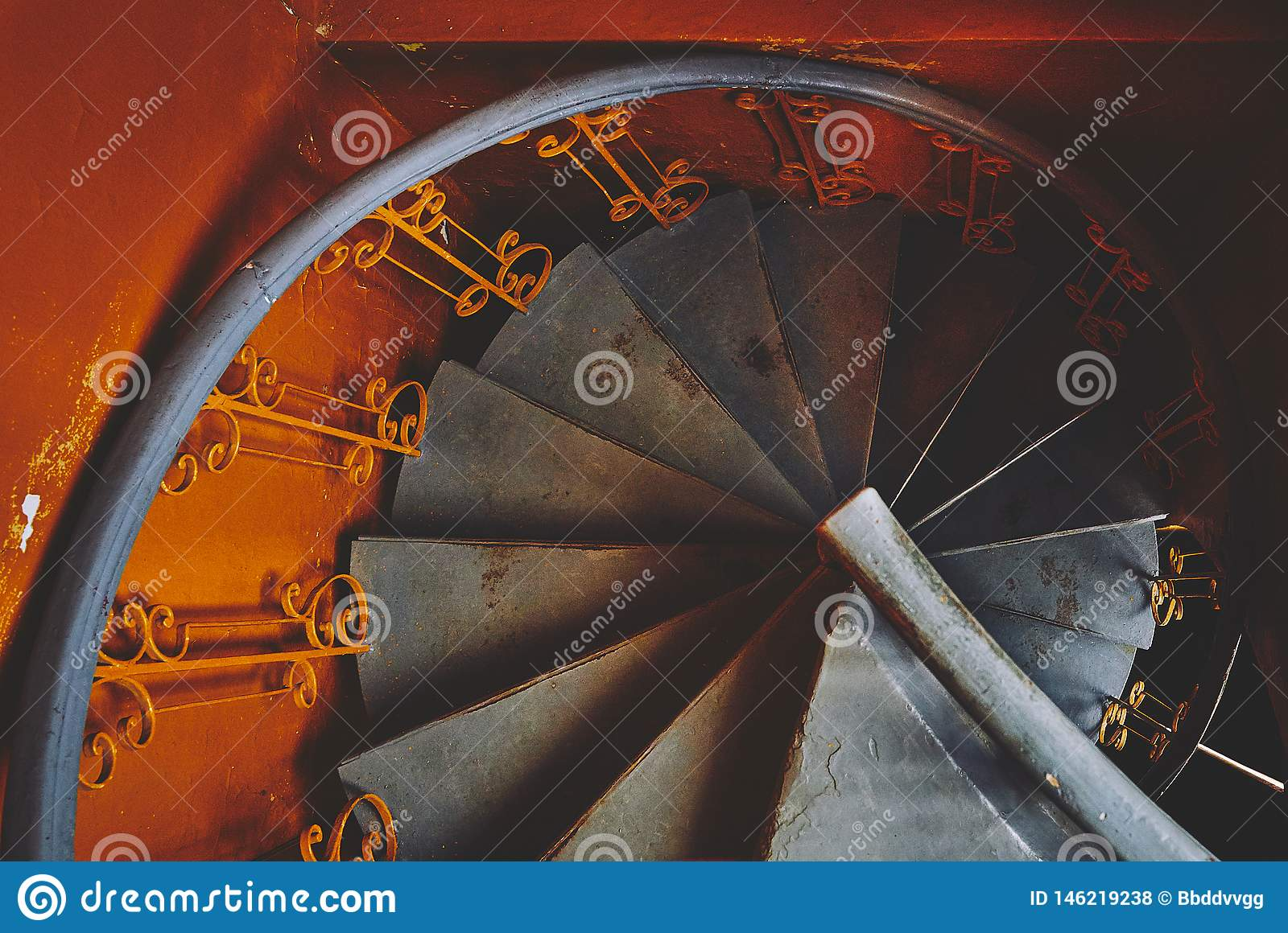 Gray spiral staircase in an old orange train, in ocher style,  spirals and descending lines of steps