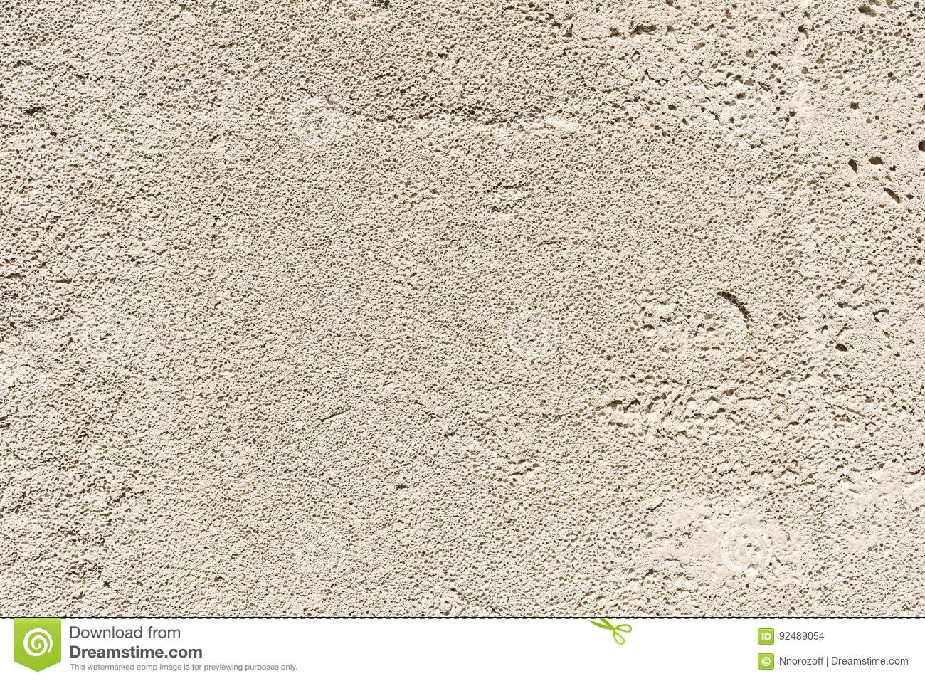 gray texture of the porous surface of concrete wall of the building