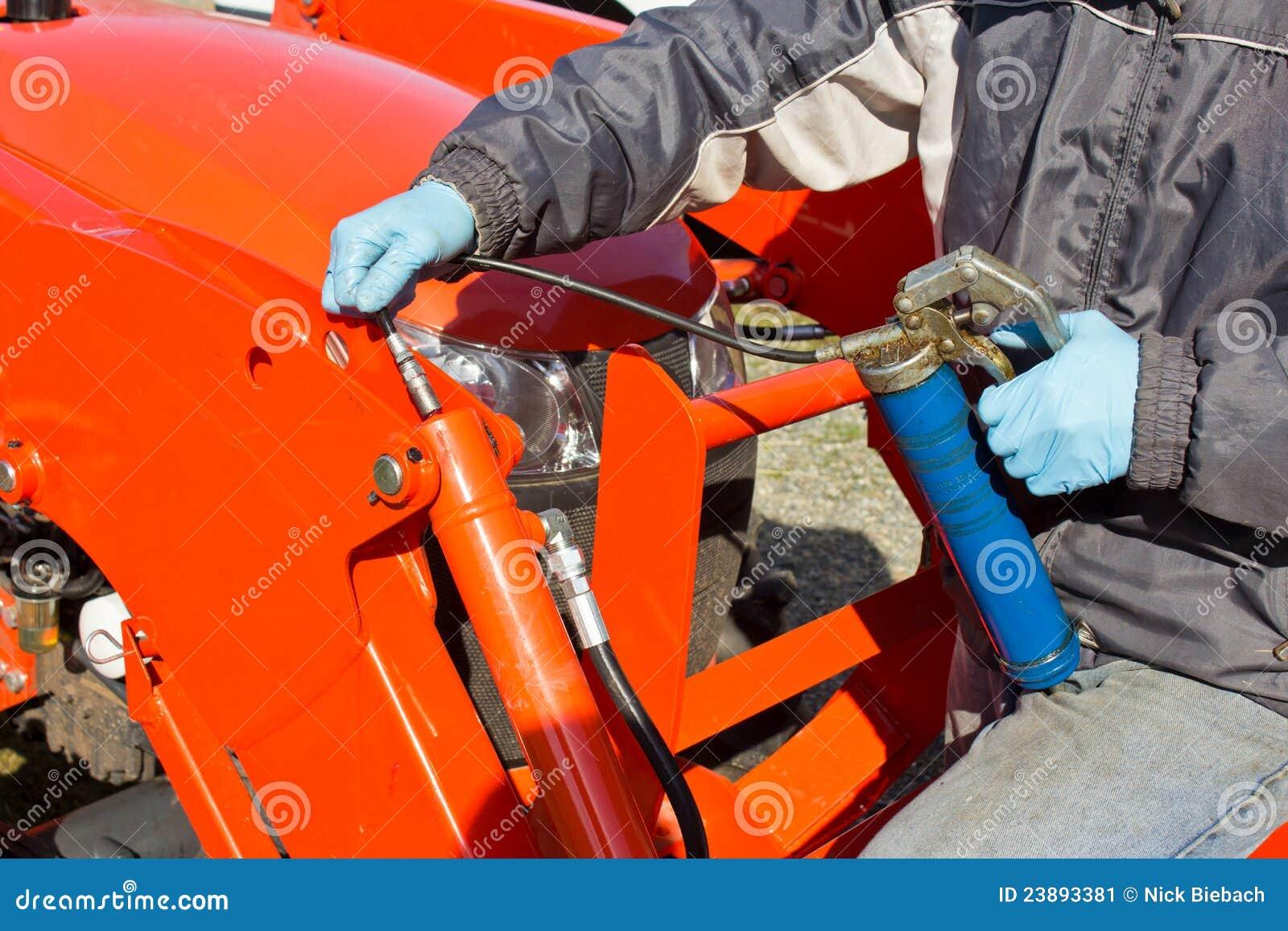 Greasing Tractor Piston