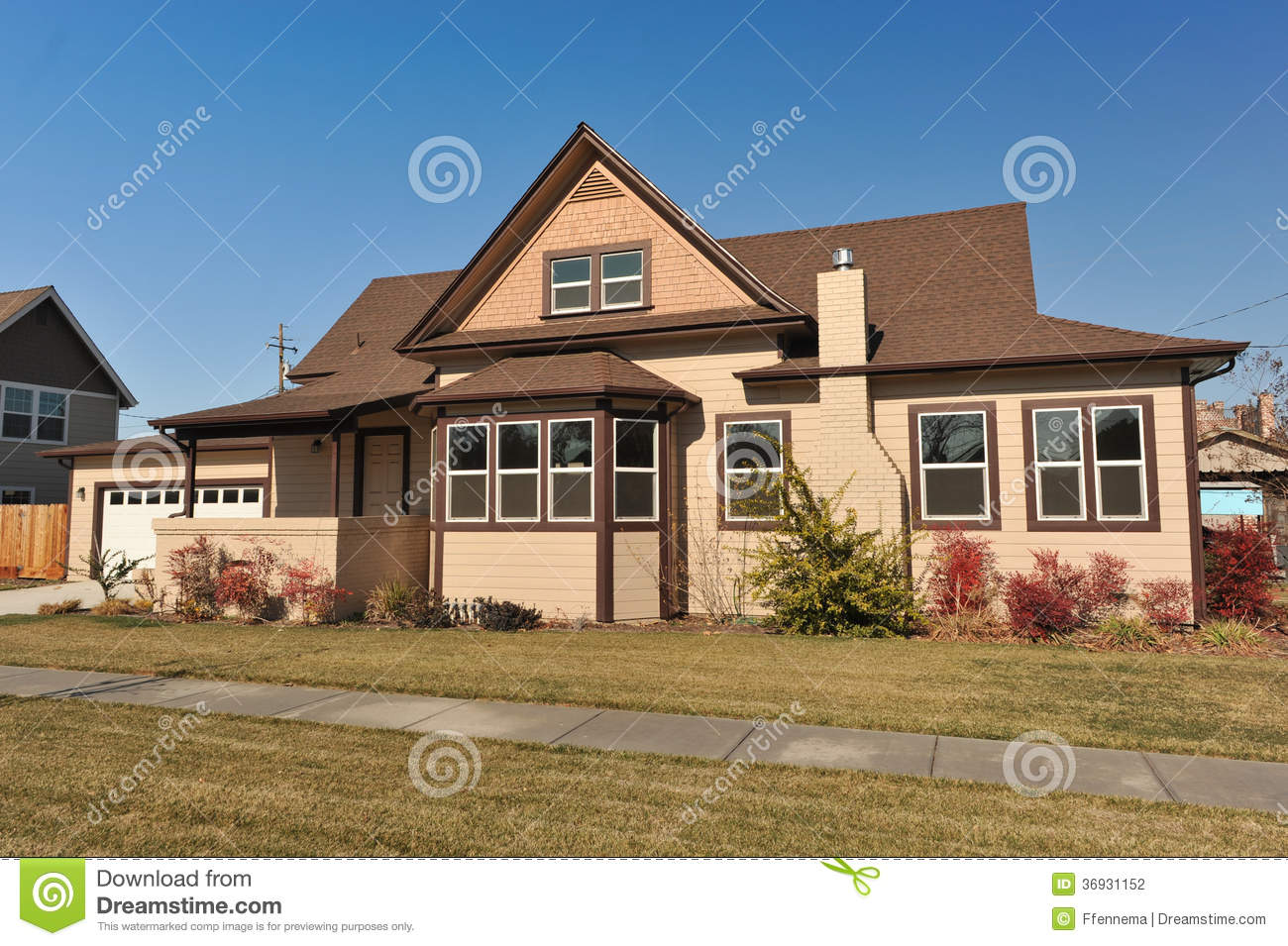 Great House With Two Stories And Trees On Side Stock Photo
