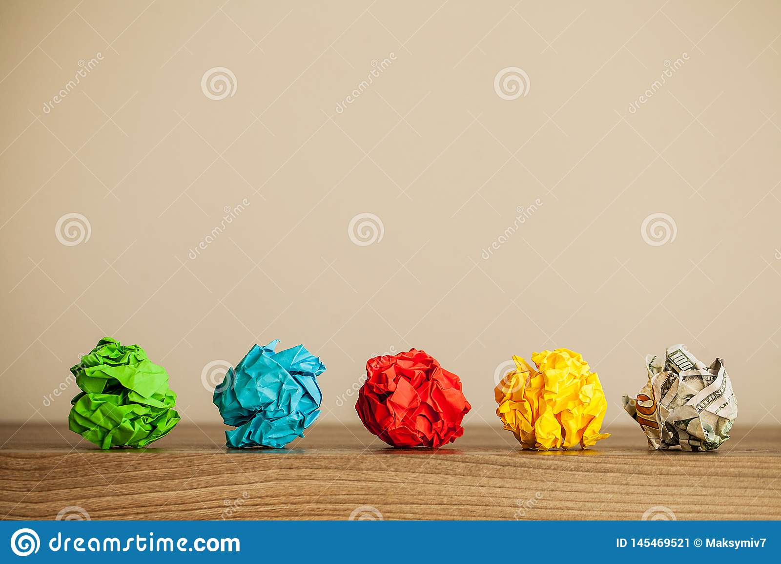 Great idea concept. Crumpled colorful paper on wooden table. Copy space
