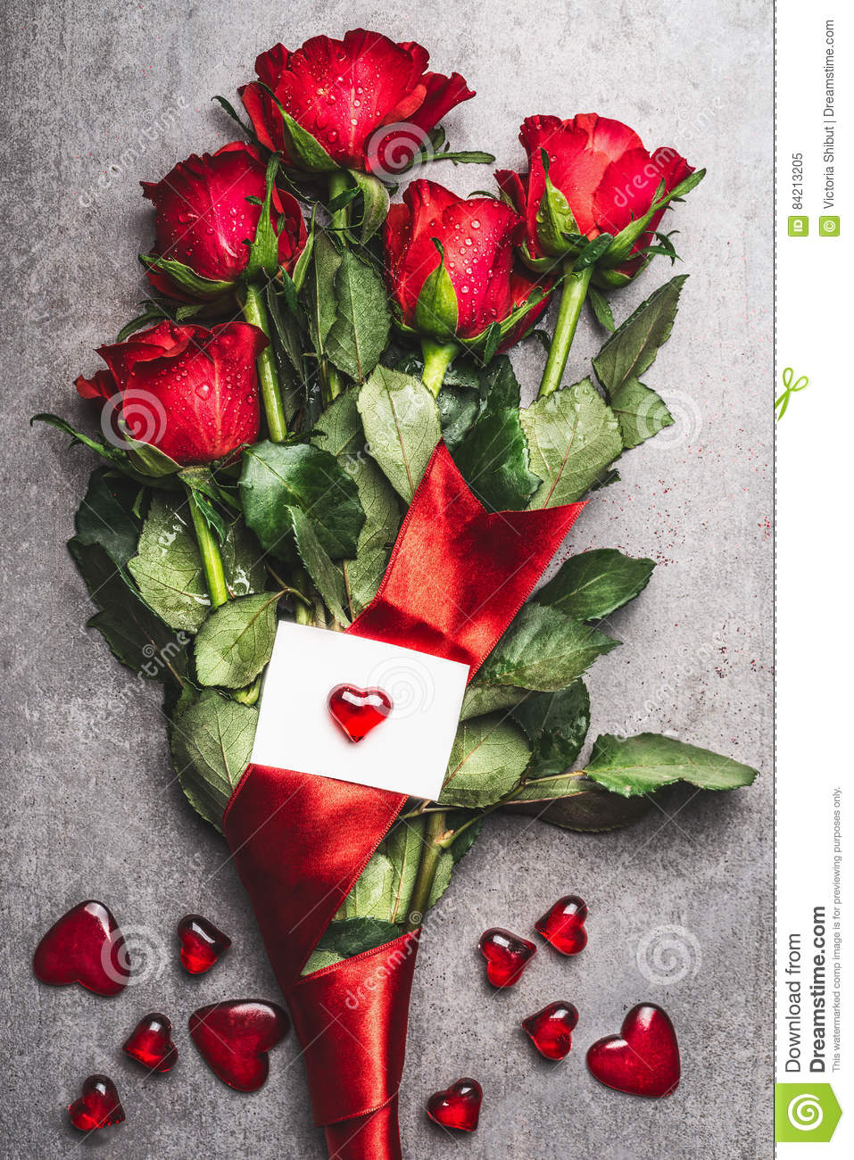 Great red roses bouquet with loop and greeting card with heart great red roses bouquet with loop and greeting card with heart top view love symbol buycottarizona