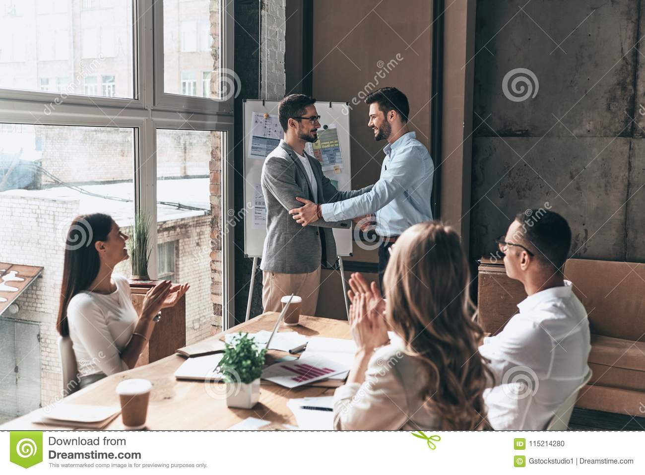 Great work! Group of business people clapping and smiling while