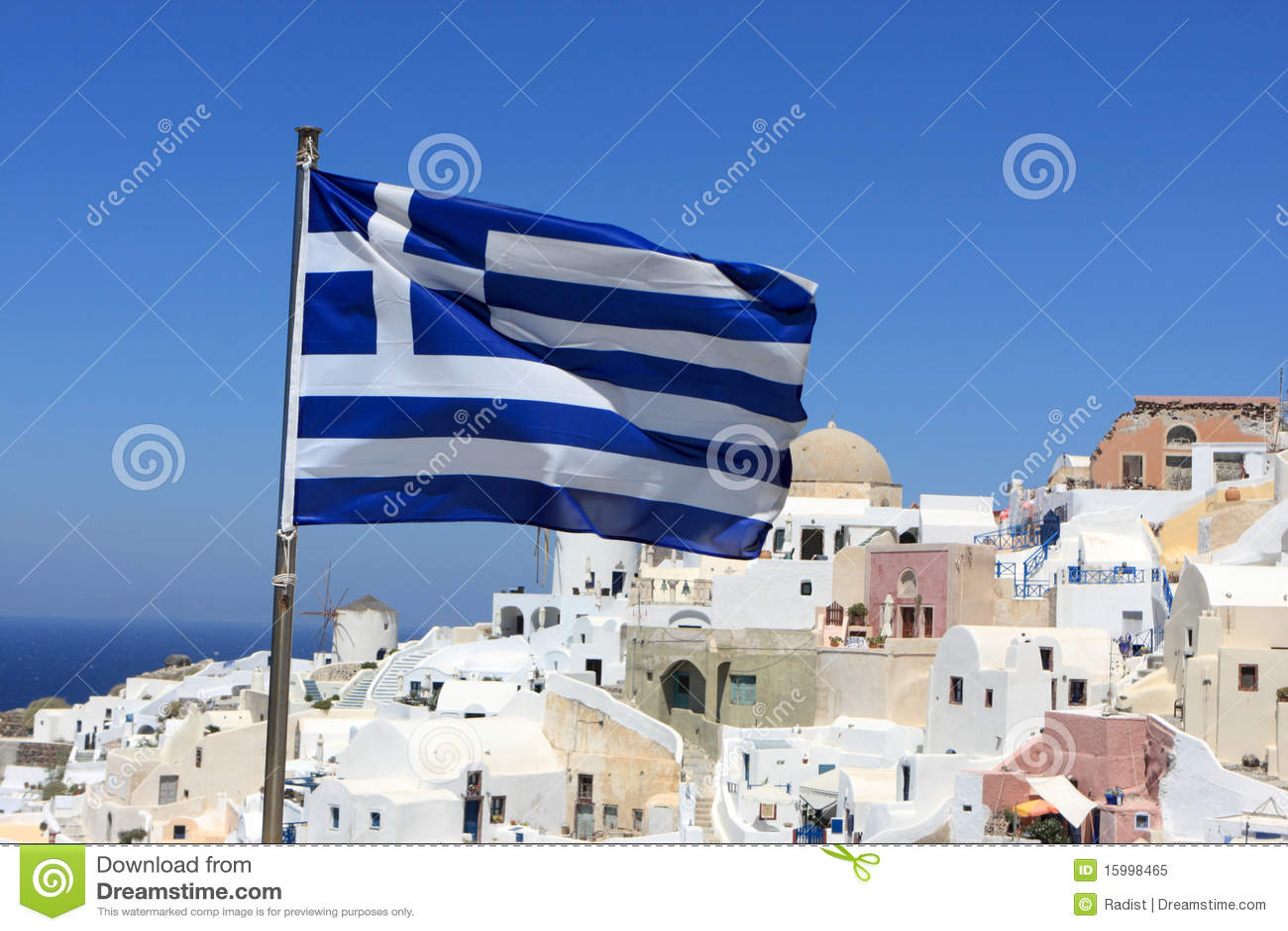 Greece flag on Oia background