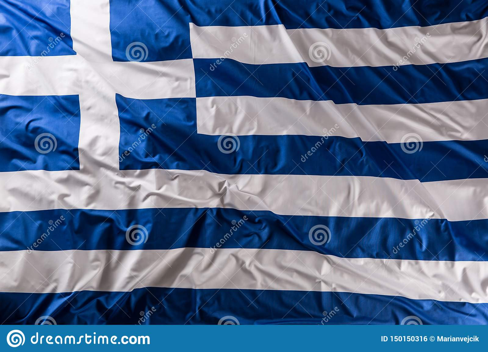 Greece flag waving in the wind - top of view