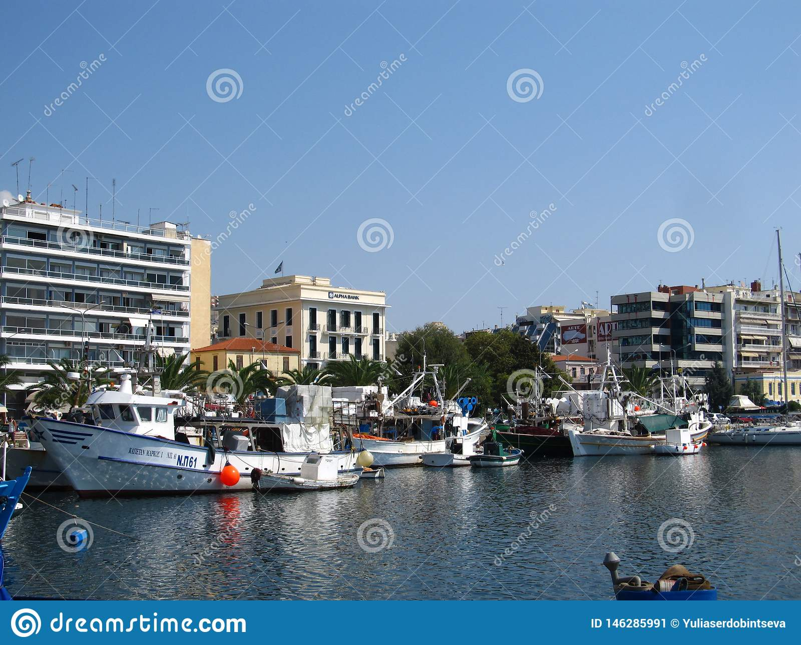 Greece, Kavala - Sertember 10, 2014. Small Greek boats moored to the shore