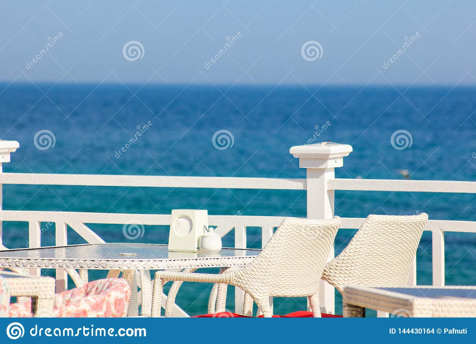 Greece, Santorini. Restaurant with served table in seafront of Aegean sea on Santorini Cyclades island with breathtaking