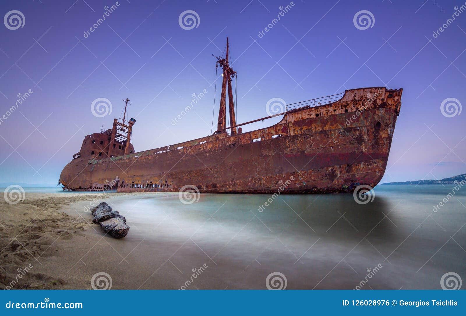 Greek coastline with the famous rusty shipwreck in Glyfada beach near Gytheio, Gythio Laconia Peloponnese.