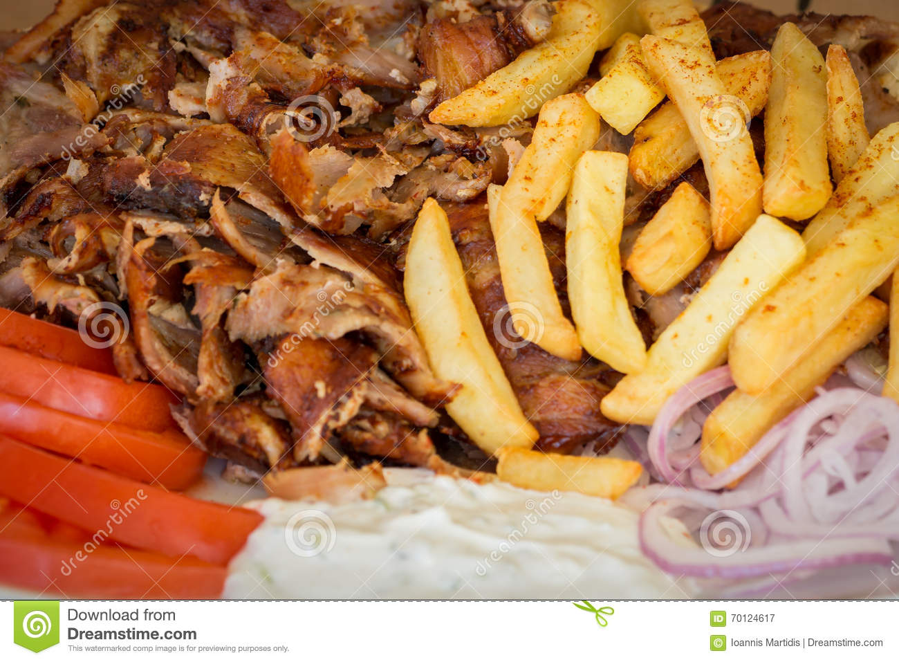 Greek gyros souvlaki meat fried potatoes tomatoes and for Authentic greek cuisine
