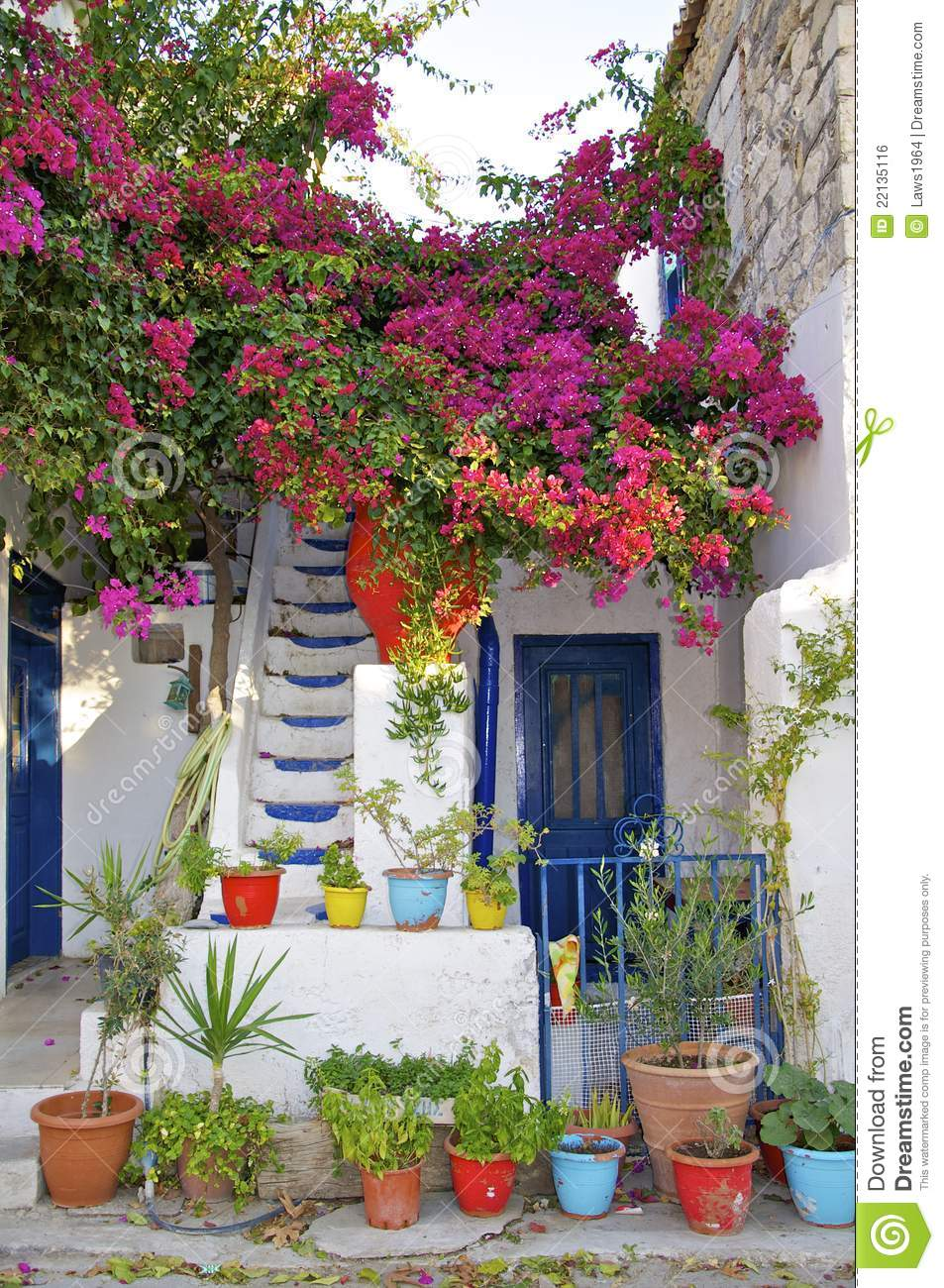 greek house full of flowers stock photo image of stairs