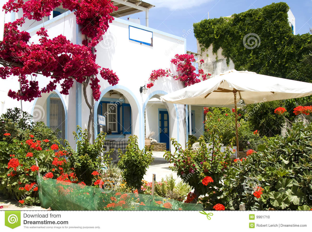 Greek island architecture beautiful flower garden stock for Beautiful flowers to plant in your garden