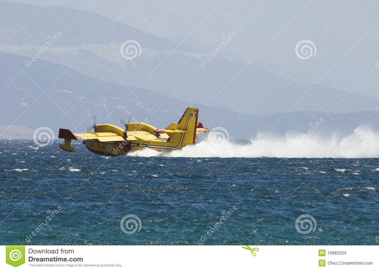 Greek pilot collects water to drop on fires