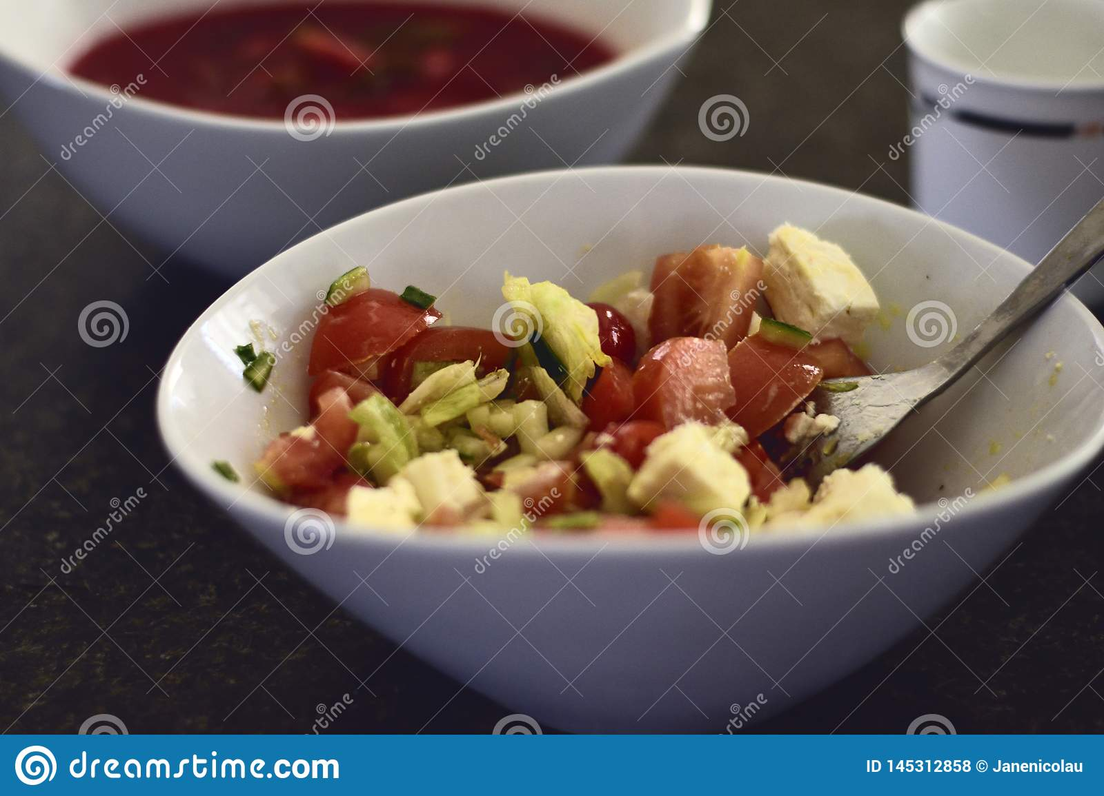 Greek salad with red beets soup background