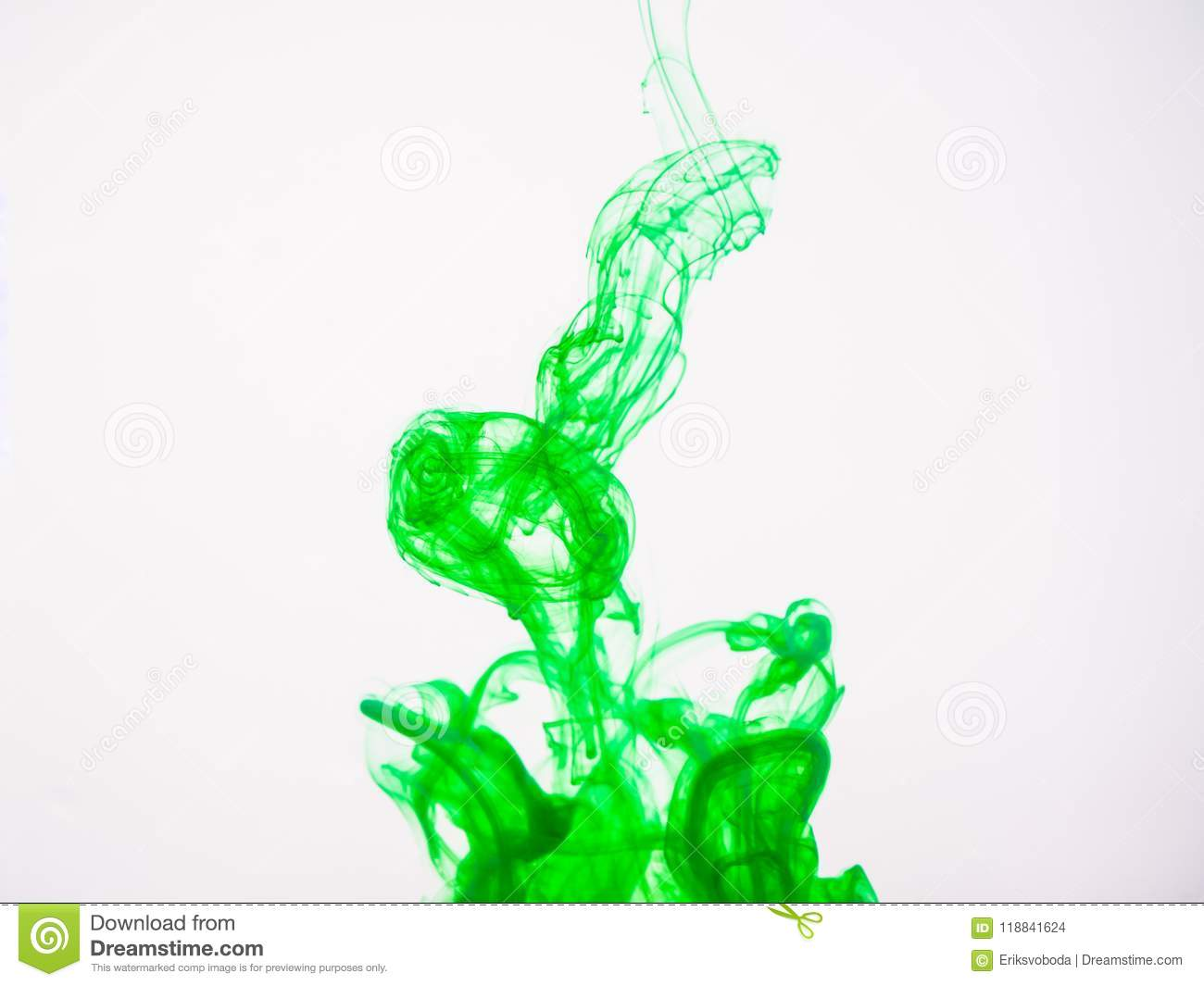 Green acrylic colour dissolving into water, close up view. Abstract green coloured background. Acrylic paint dropped
