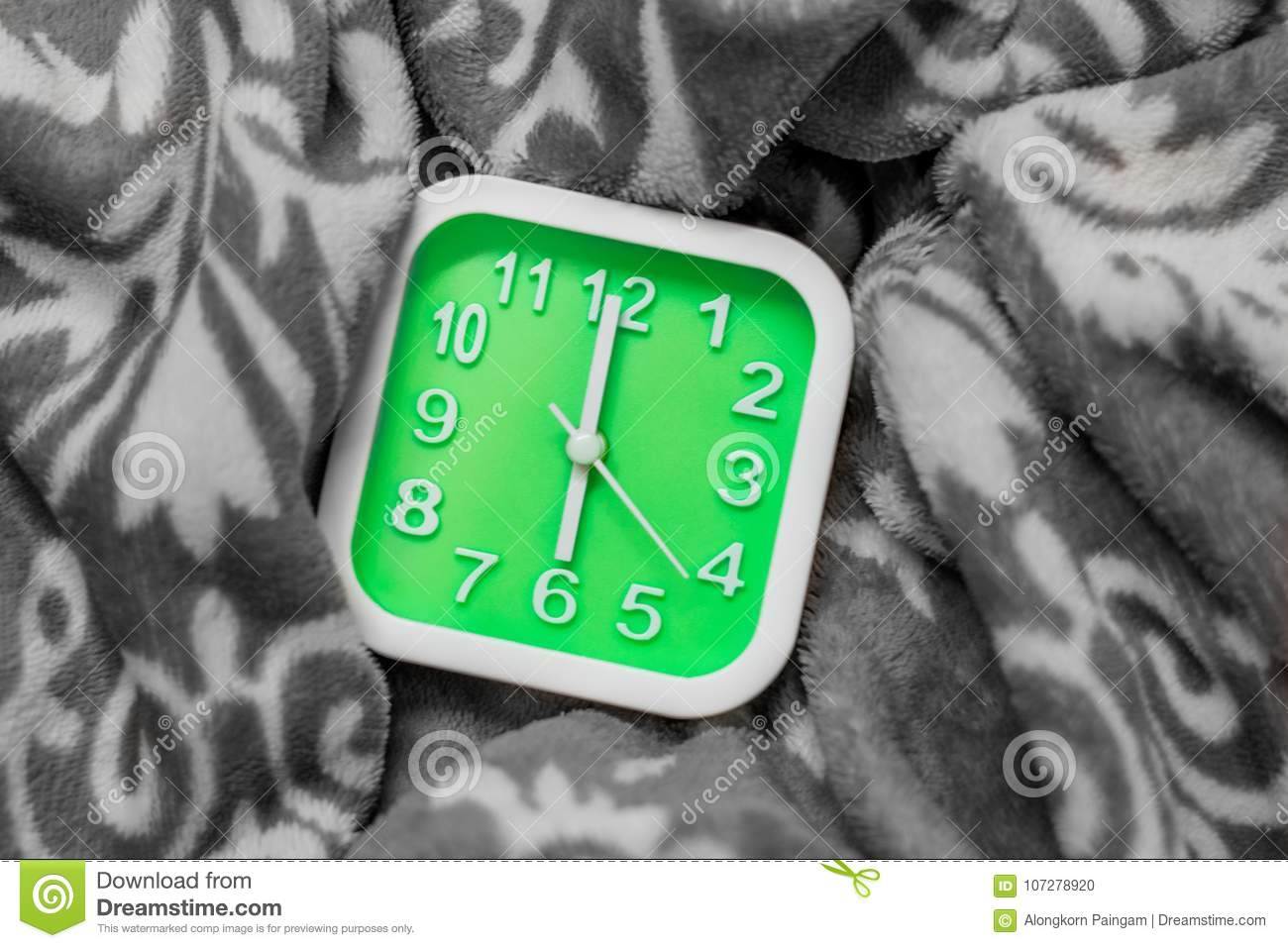 Green Alarm Clock On The Bed  It Alarm At 6 00 AM On Workday