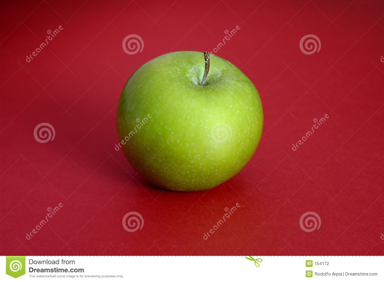 Green apple on red background