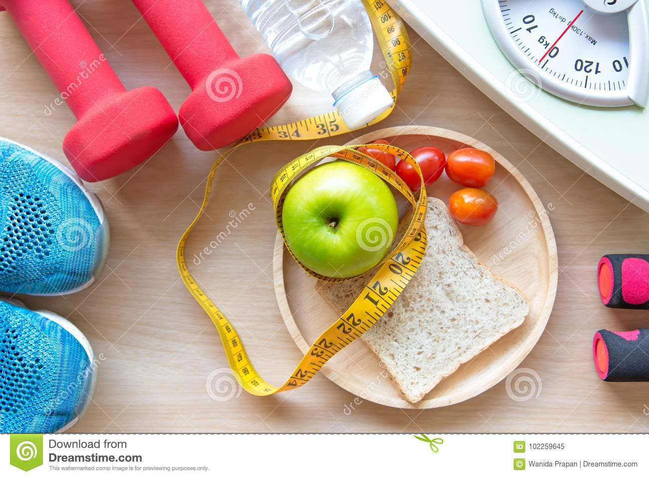 Green apple and Weight scale, measure tap with clean water and sport equipment for women diet slimming.