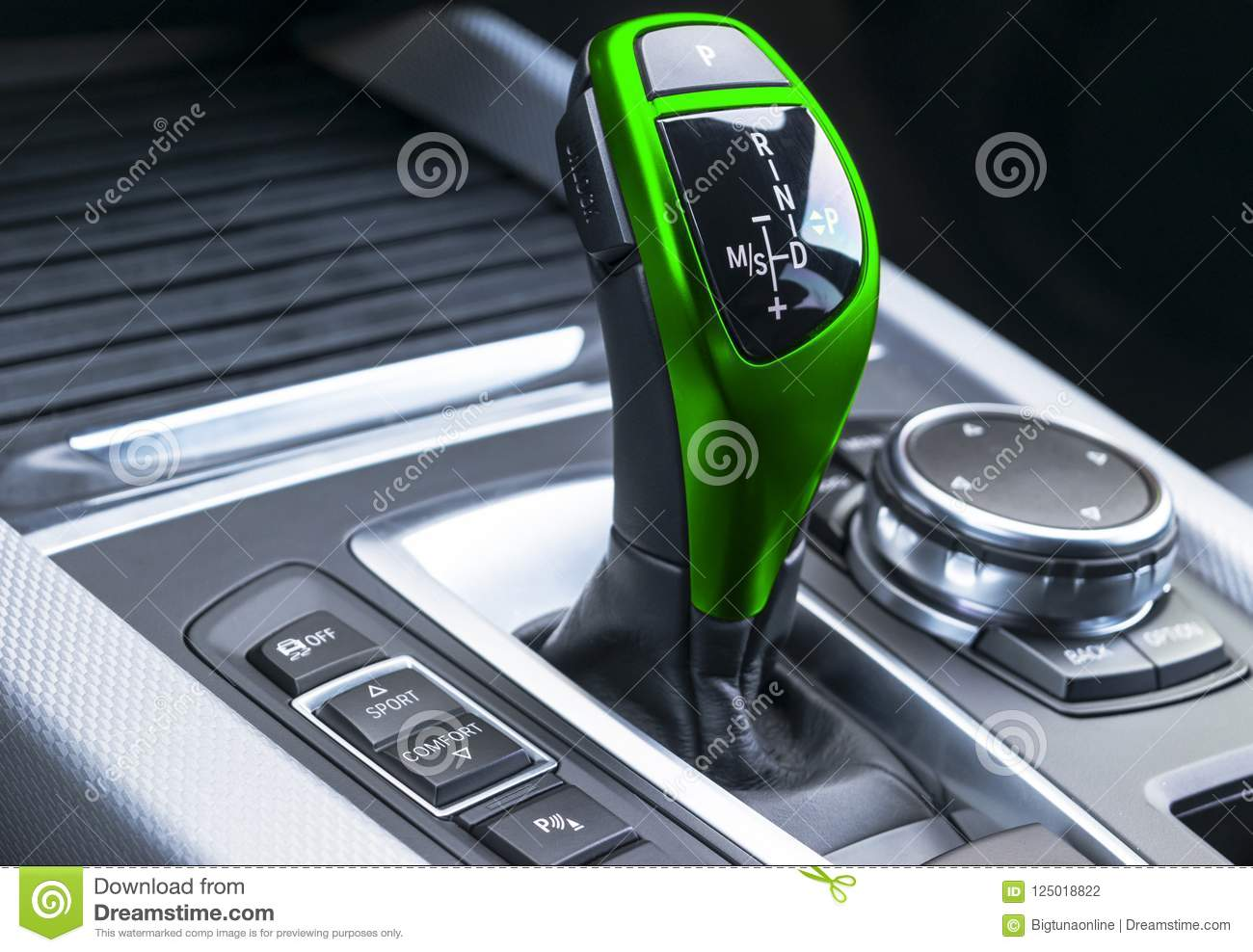 Green Automatic gear stick of a modern car. Modern car interior details. Close up view. Car detailing. Automatic transmission leve