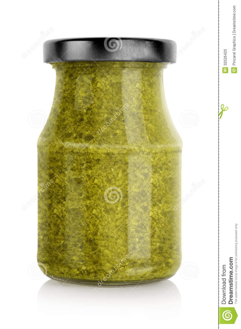 Jar filled with green basil pesto sauce, isolated on a white ...