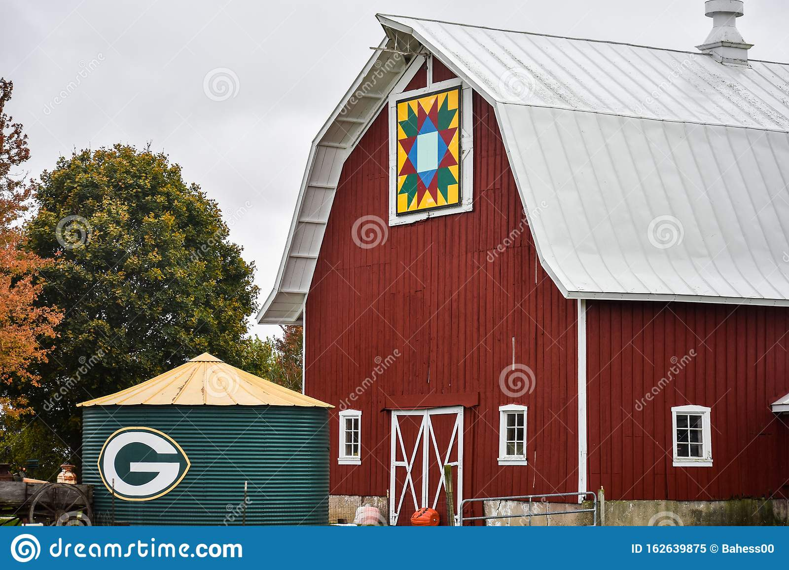 Green Bay Packers Symbol On Short Silo And A Red Quilt ...
