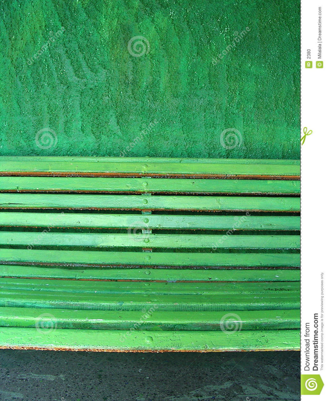 Green bench on a green wall