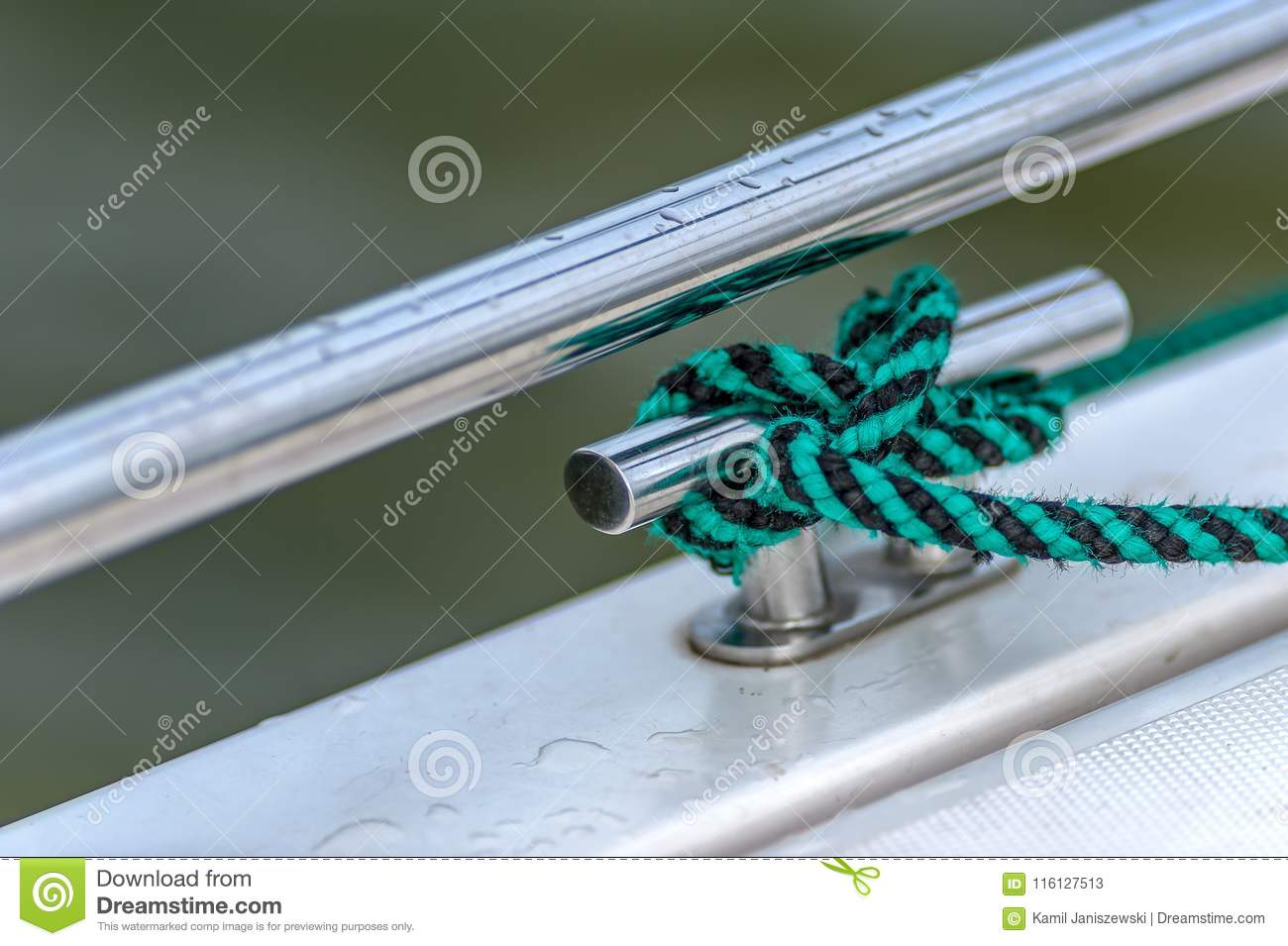 Green Black Rope Wrapped Around A Cleat Stock Image Image Of