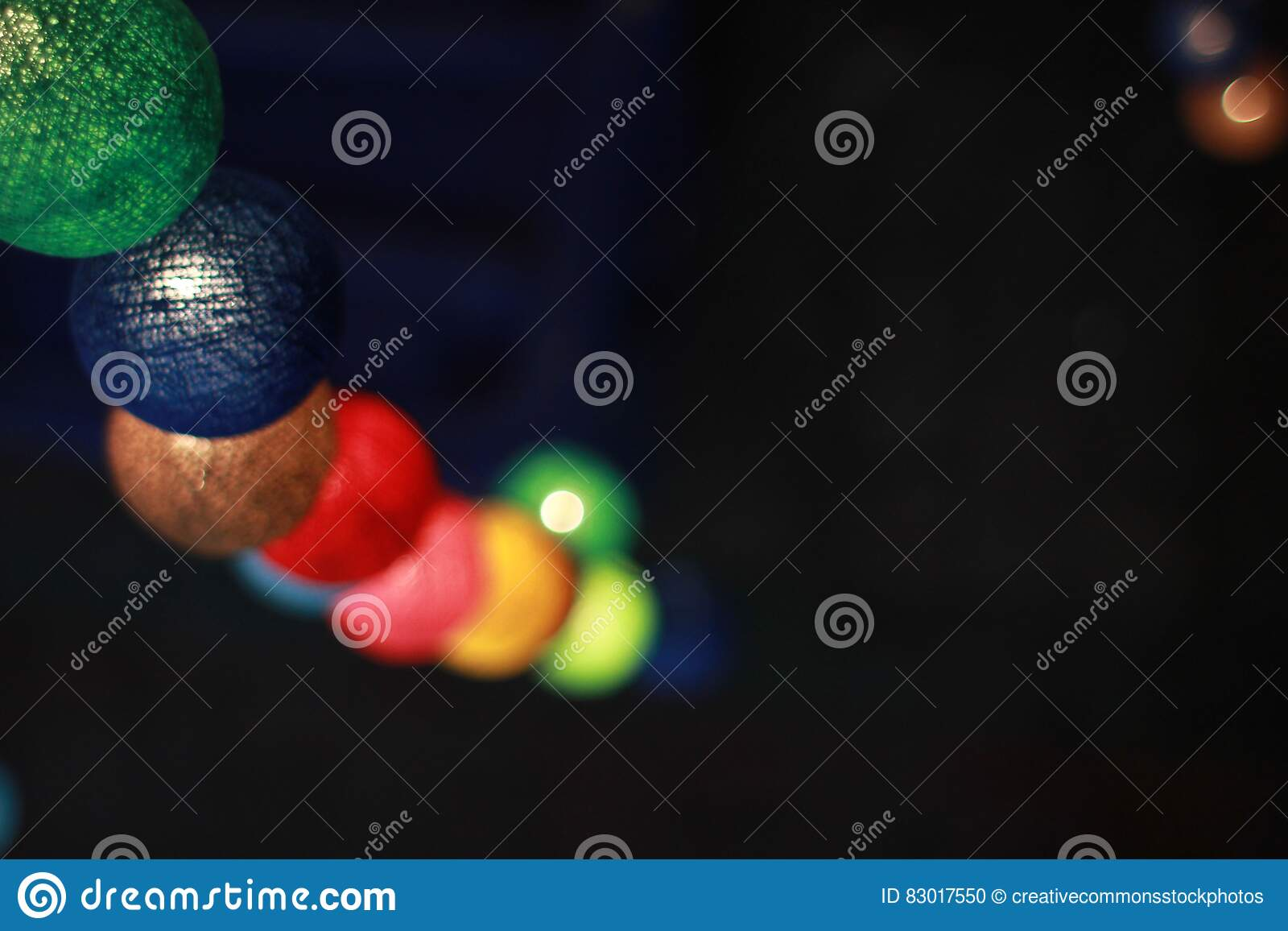 Download Green Blue And Brown Multicolored Ball Ornament Stock Photo - Image of colorful, lights: 83017550