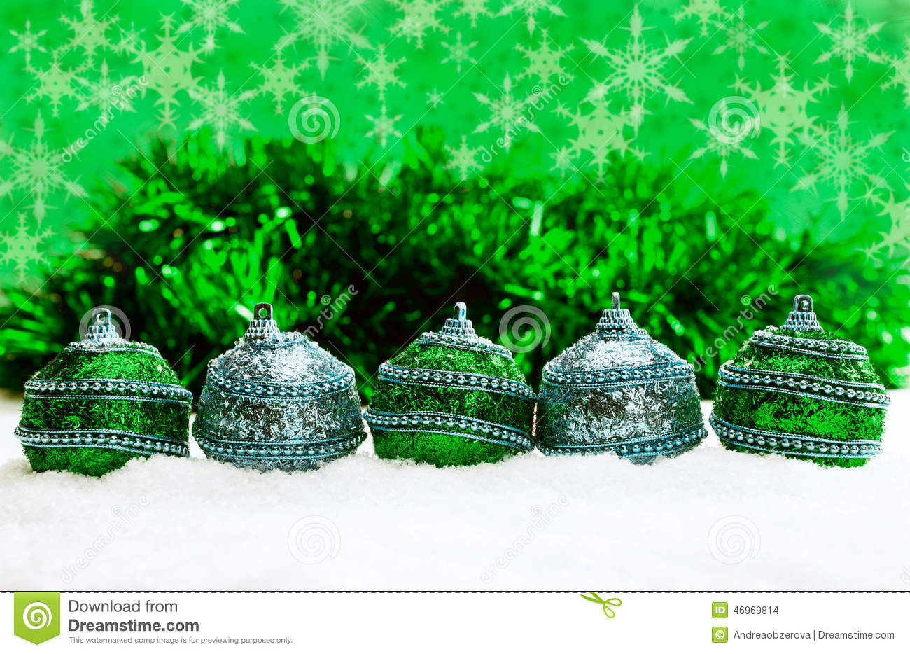 Green And Blue And Silver Christmas Balls In Snow With