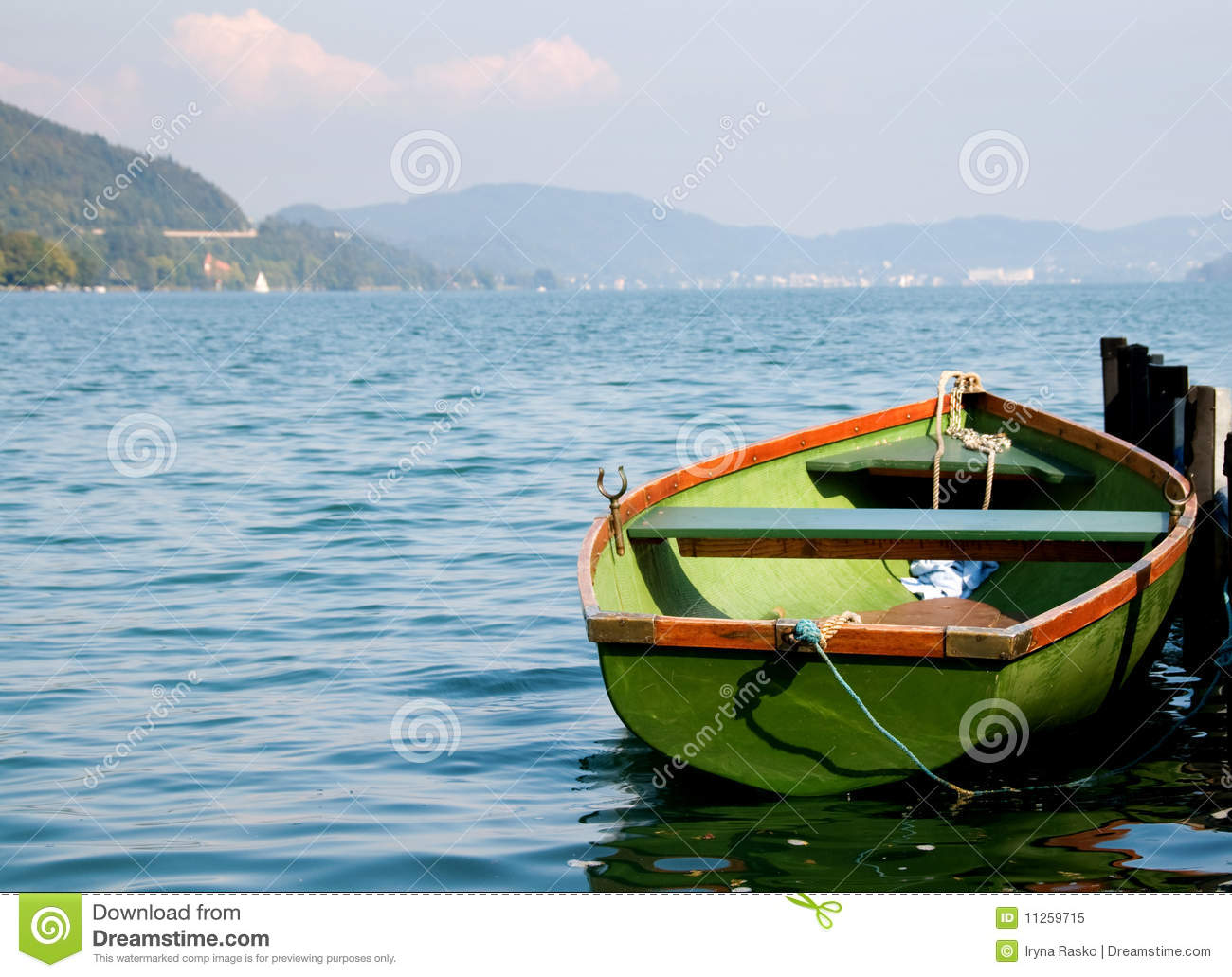 Green Boat On Water With Mountains On Background Royalty Free Stock Photo - Image: 11259715