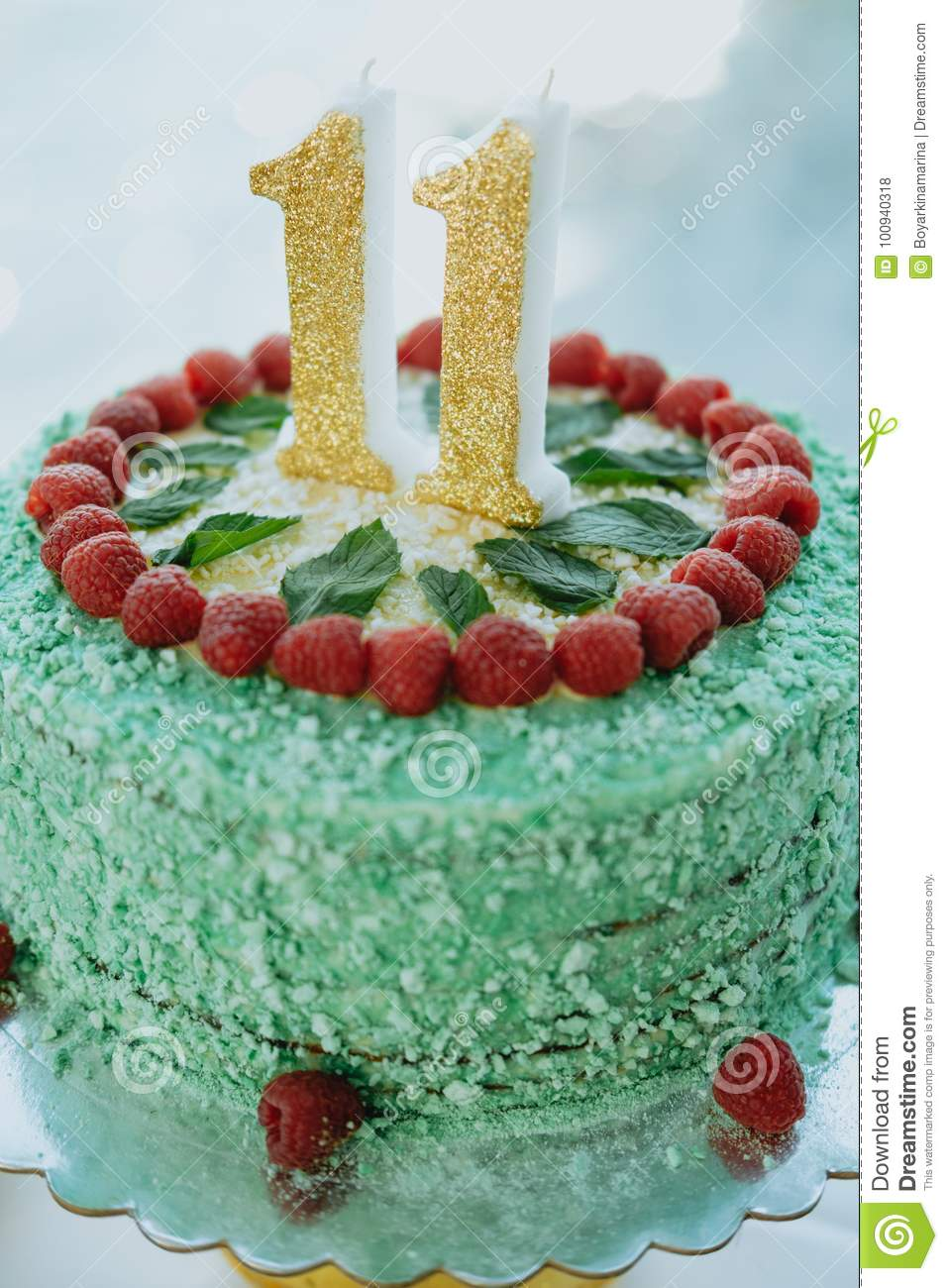 Green Cake With Number 11 On The Table