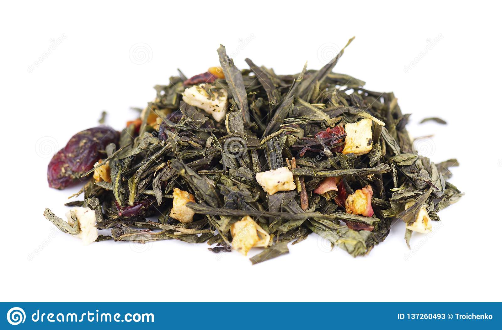 Green Ceylon tea with berries and fruits - apple, dog-rose, strawberry and cranberry, isolated on white background.