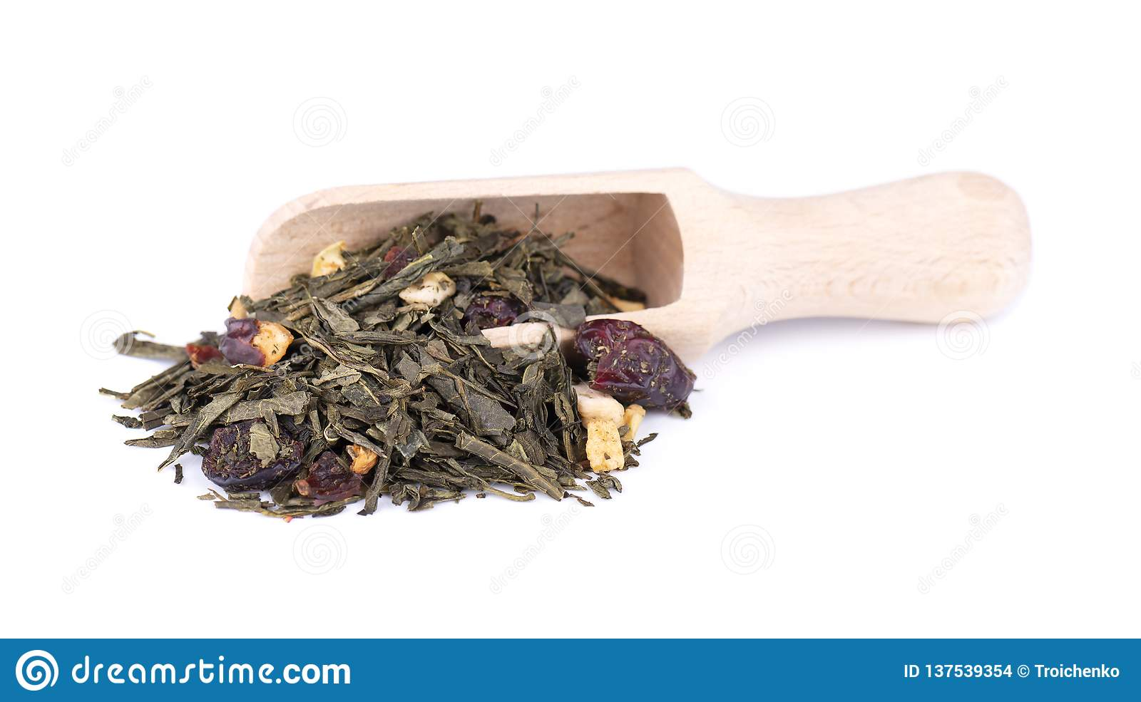 Green Ceylon tea with berries and fruits - apple, dog-rose, strawberry and cranberry, isolated on white background. Top