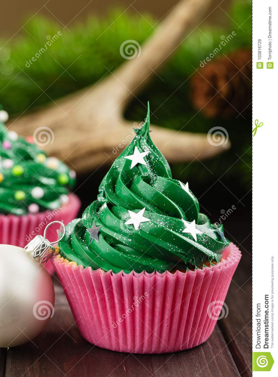 Green christmas cupcake with festive decorations