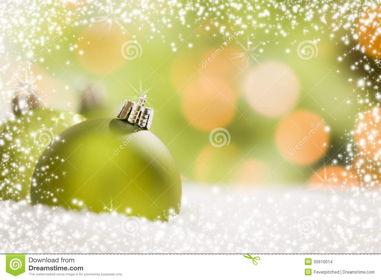 green christmas ornaments on snow over an abstract