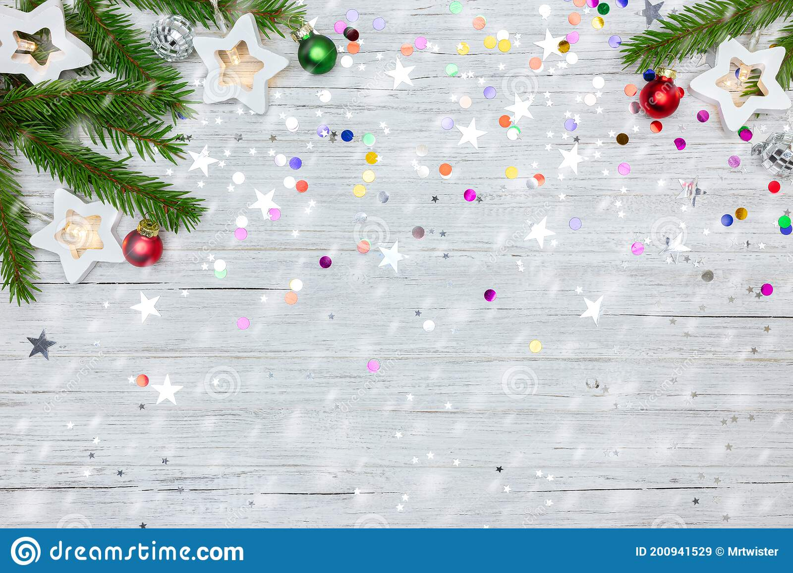 Green Christmas Tree Branch And Star Lights On White Wooden Background With Colorful Confetti Stock Image Image Of Bauble Colorful 200941529