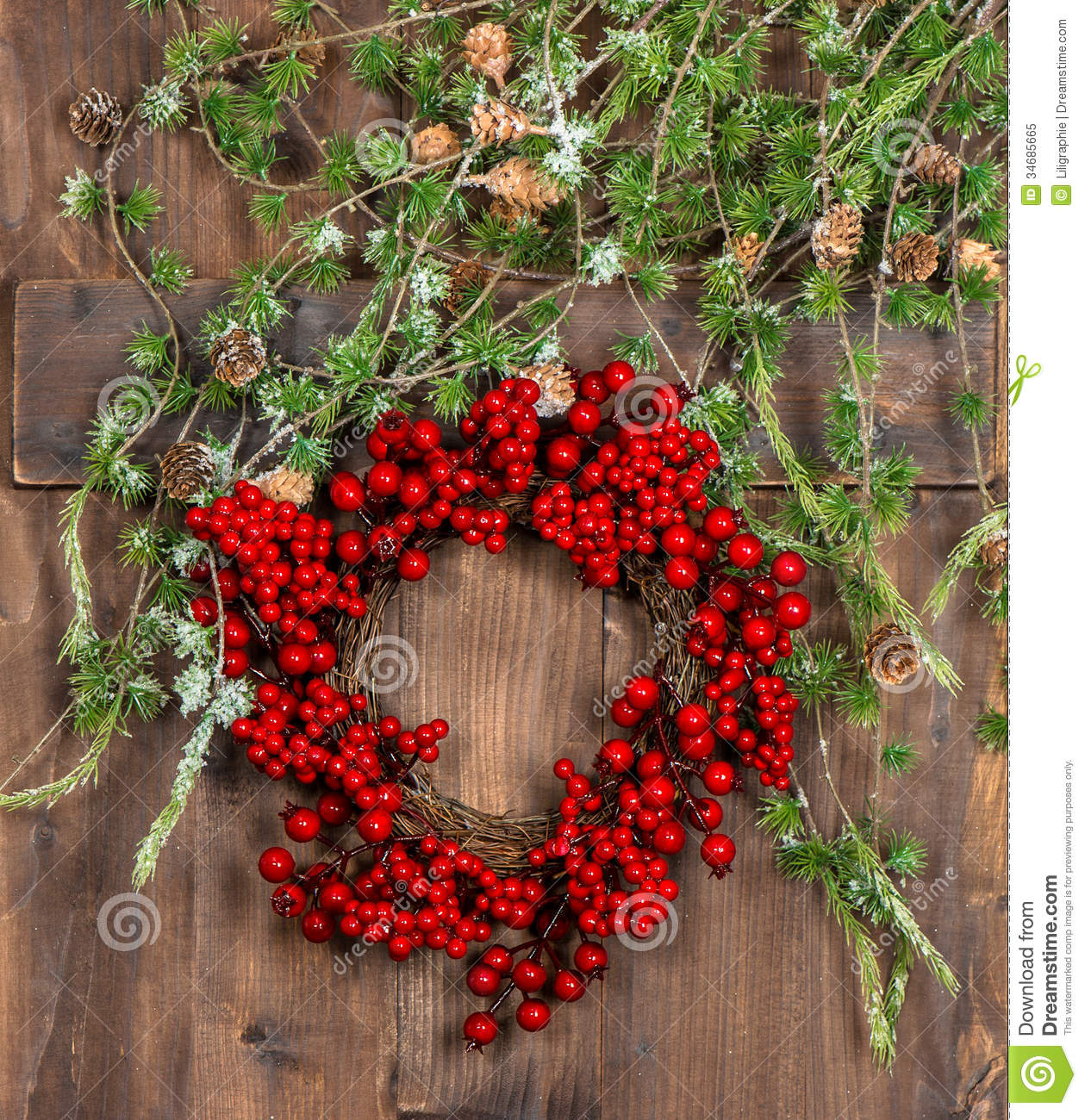 Green Christmas Tree Branches And Wreath From Red Berries Royalty ...