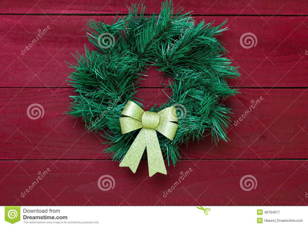 Green Christmas Wreath With Gold Bow Hanging On Antique ...